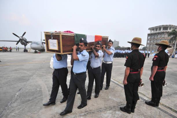 Indian Air Force Jawans carry the coffin of Garud Commando CPL Nilesh Kumar Nayan after his mortal remains were brought at Air Force Station in on...