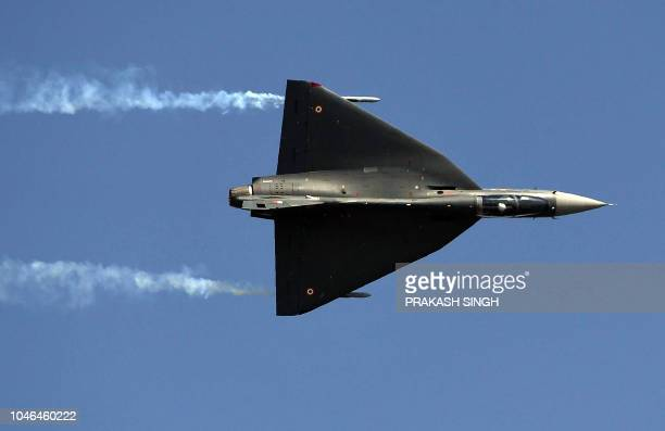 Indian Air Force Light Combat Aircraft Tejas fly past during a full dress rehearsal for the Air Force Day parade at the Air Force Station Hindon in...