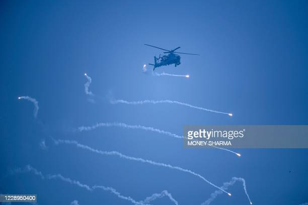Indian Air Force Mi35 Apache helicopter performs during the 88th Air Force Day parade at Hindon Air Force station in Ghaziabad on October 8, 2020.