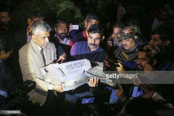 Indian Air Force officials show a section of an exploded AMRAAM missile said to be fired by Pakistan Air Force F16 during a joint press conference of...
