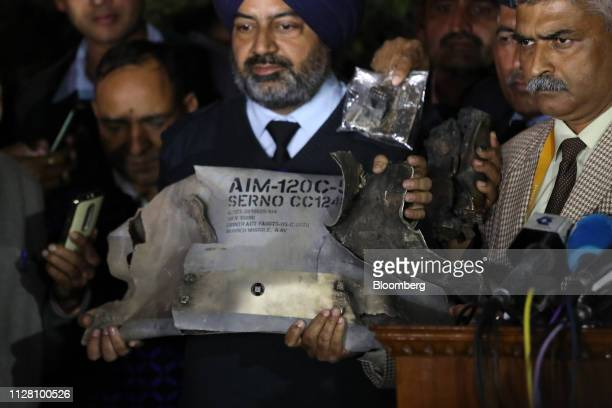 Indian Air Force officials show sections of an exploded Amraam missile said to be fired by Pakistan Air Force F16s at an IAF Army and Navy joint...