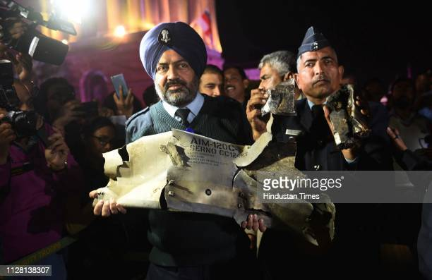 Indian Air Force officials show sections of an exploded AMRAAM missile said to be fired by Pakistan Air Force F16s which were found in Rajouri...