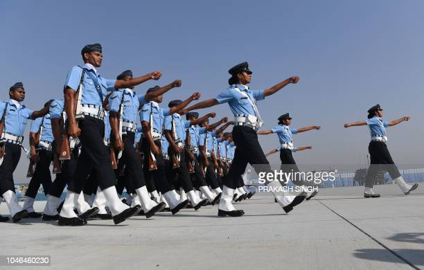 Indian Air Force personnel march during a full dress rehearsal for the Air Force Day parade at the Air Force Station Hindon in Ghaziabad town on the...