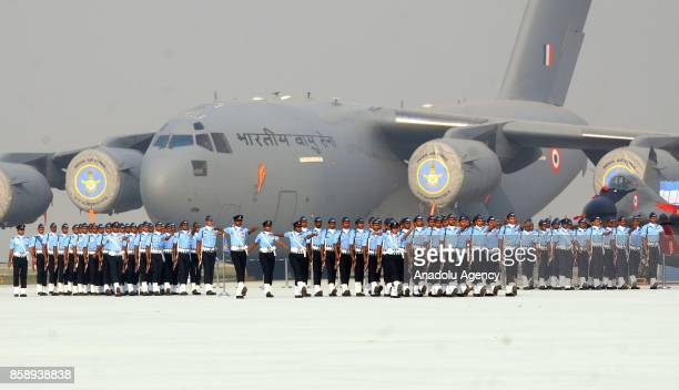 Indian Air Force personnel march during the Air Force Day parade at the Hindon Air Force Station in Ghaziabad on the outskirts of New Delhi India on...