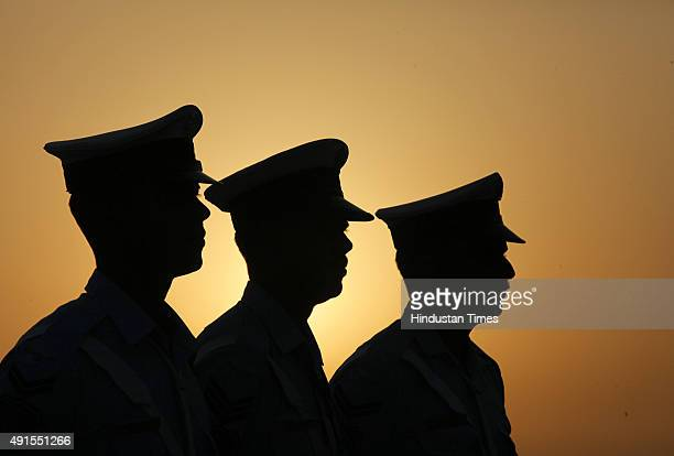 Indian Air Force personnel march past during full dress rehearsal early morning ahead of the Air Force Day during full dress rehearsal function at...