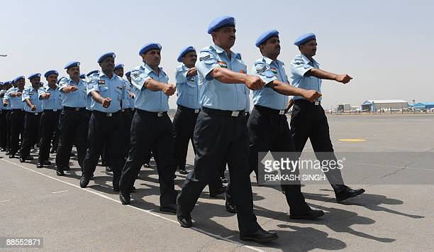 Indian Air Force personnel part of a UN Peacekeeping mission to the Democratic Republic of Congo listen to the OfficerinCharge during the flagoff...