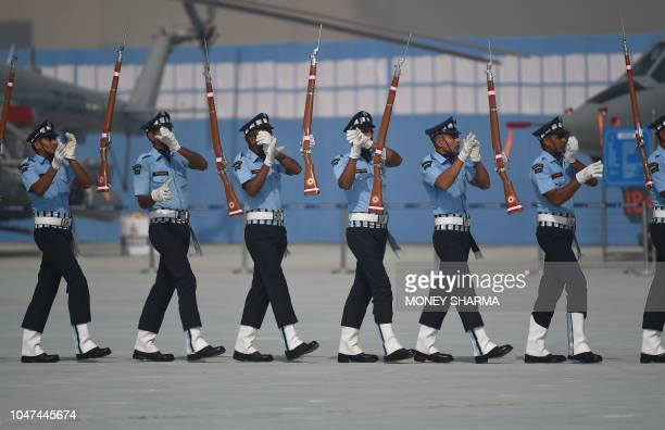 TOPSHOT Indian Air Force personnel perform a drill during the Air Force Day parade at the Air Force station Hindon in Ghaziabad town on the outskirts...