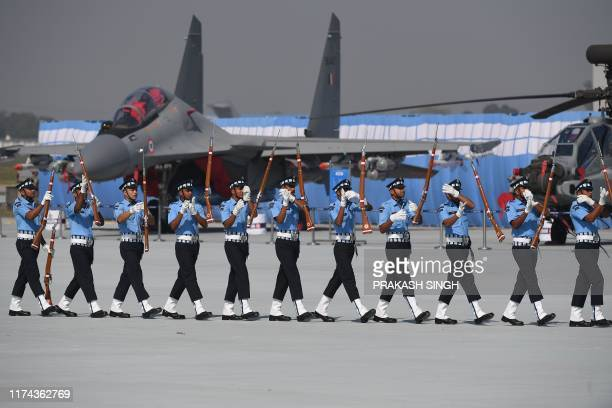 Indian Air Force personnel perform a drill during the Air Force Day parade at an IAF station in Ghaziabad on the outskirts of New Delhi on October 8...