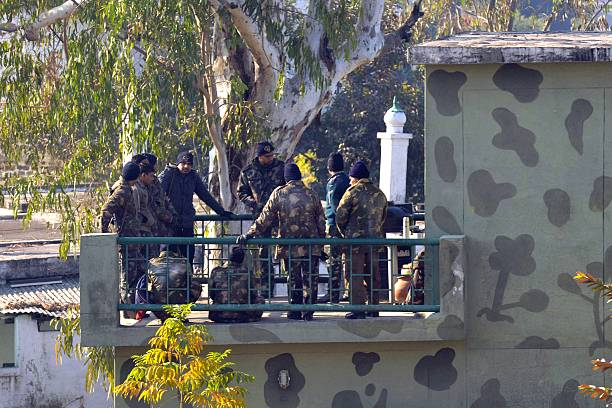 Indian Air Force personnel stand on the roof of a building at an airforce base in Pathankot on January 3 during an operation to `sanitise` the base...