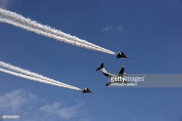 Indian Air Force planes take part in a flypast during a full dressrehearsal ahead of the nation's Republic Day celebrations in New Delhi on January...