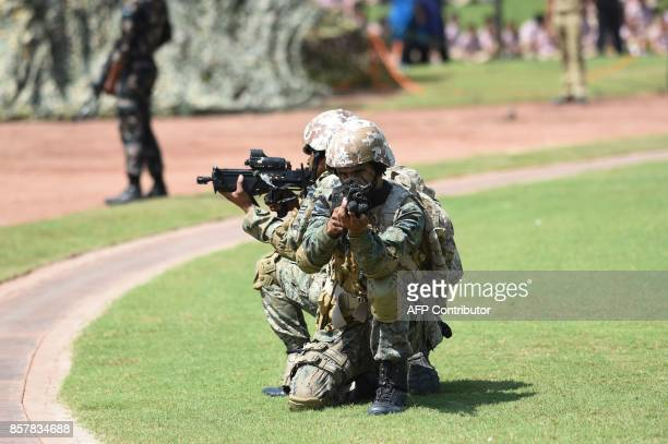 Indian Air Force Special Force's Garud commandos take position during a mock operation on the first day of the two day campaign 'Know Your Air Force'...