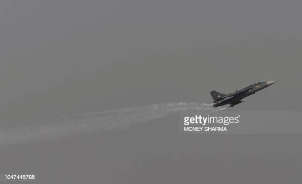 Indian Air Force 'Tejas' fighter jet performs a manouevre during the Air Force Day parade at the Air Force station Hindon in Ghaziabad town on the...