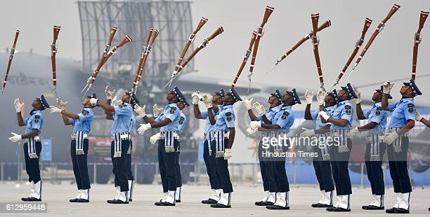 Indian Air Force's 'Air Warrior' drill team performs during the 84th anniversary of Air Force Day parade rehearsals at the Air Force Station Hindon...