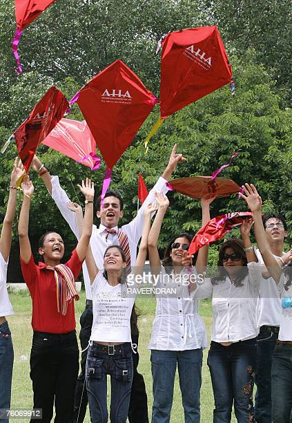 Indian Air Hostesses play with kites at a Kite Flying contest organised by the Air Hostess Academy in anticipation of the upcoming 60th Independence...