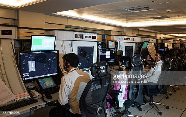 Indian air traffic controllers work at the Air Traffic Control Tower building at Netaji Subhash Chandra Bose International Airport in Kolkata on...