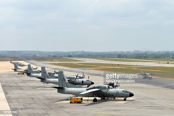 Indian Airforce AN32 and Dornier228 aircraft stand parked on the tarmac at the Yelahanka Airforce Station in Bangalore on October 3 2013 The Indian...