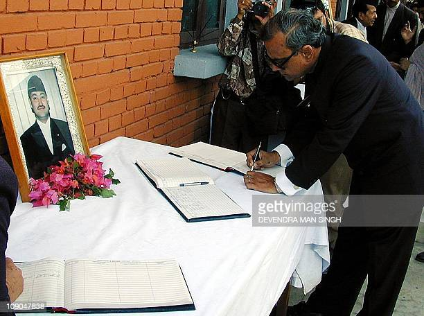 Indian Ambassador to Nepal Pranav Mukarjee signs the condolence book before the portrait of the late King Dipendra at Narayan Hity Royal Place in...
