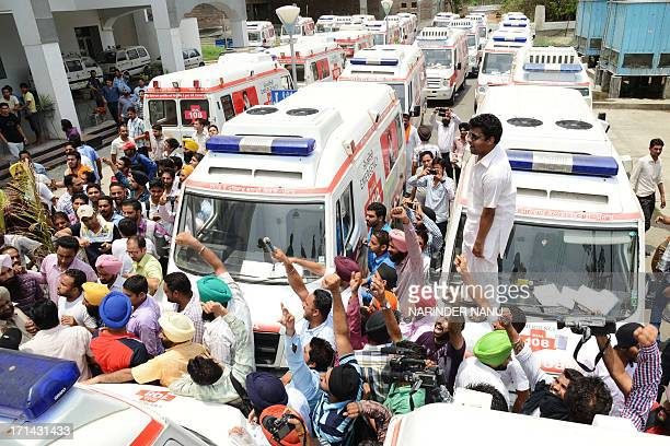 Indian ambulance staff protest against private company Ziqitza Healthcare during a demonstration at Guru Nanak Hospital in Amritsar on June 242013...