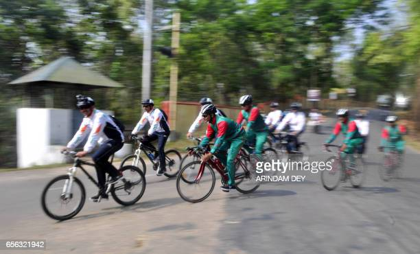 Indian and Bangladesh army personnel ride their bicycles in Agartala on March 22 at the start of a joint IndoBangladesh Army cycling expedition A...
