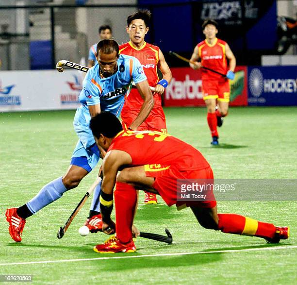 Indian and Chinese players vie for the ball during the FIH Hockey World League Round2Men at National Stadium on Saturday
