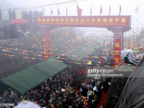 Indian and Chinese traders cross the ChinaIndia border at the 15000feet Nathu La Pass in India's northeastern state of Sikkim 06 July 2006 India and...