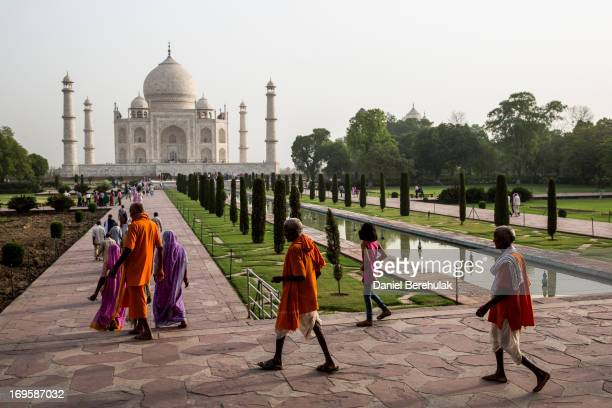 Indian and foreign tourists visit the Taj Mahal on May 28 2013 in Agra India Completed in 1643 the mausoleum was built by the Mughal emperor Shah...