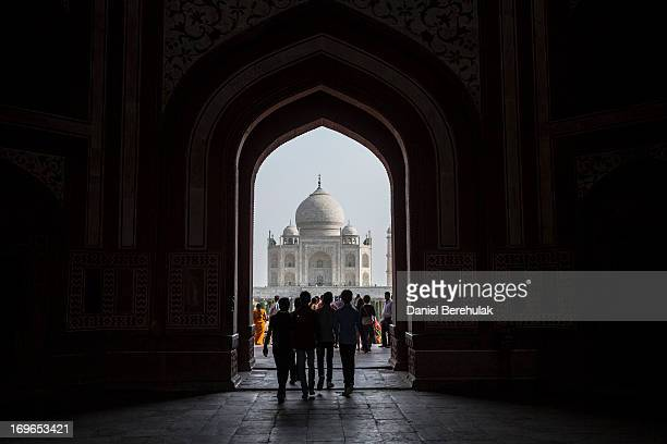 Indian and foreign tourists visit the Taj Mahal on May 30 2013 in Agra India Completed in 1643 the mausoleum was built by the Mughal emperor Shah...