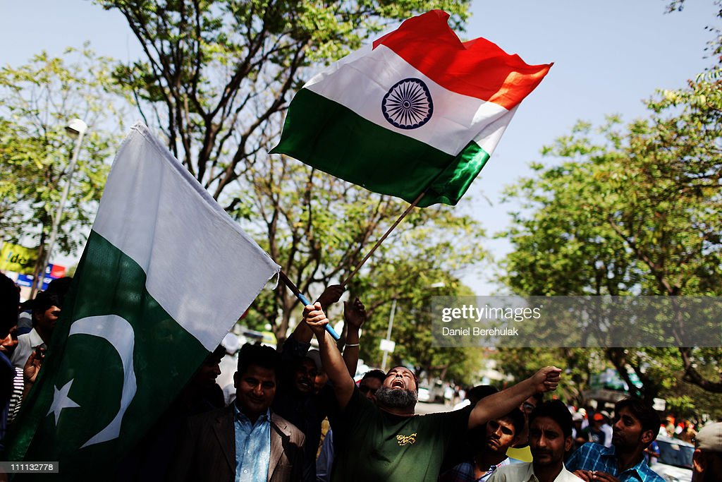 Indian and Pakistan fans wave flags prior to the start of the 2011 ICC World Cup second SemiFinal between India and Pakistan at Punjab Cricket...
