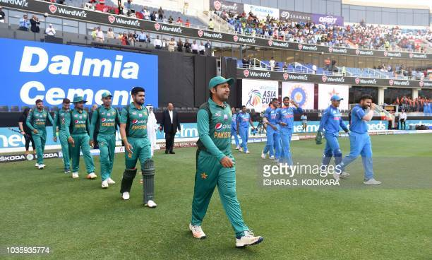 Indian and Pakistan players line up before the start of the one day international Asia Cup cricket match between Pakistan and India at the Dubai...