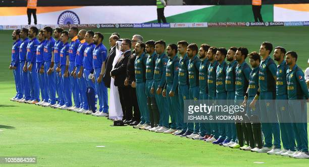 Indian and Pakistan players line up for the national anthem just before the start of the one day international Asia Cup cricket match between...