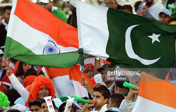 Indian and Pakistani cricket fans celebrate during the ICC Champions Trophy match between Pakistan and India on September 19 2004 at Edgbaston in...