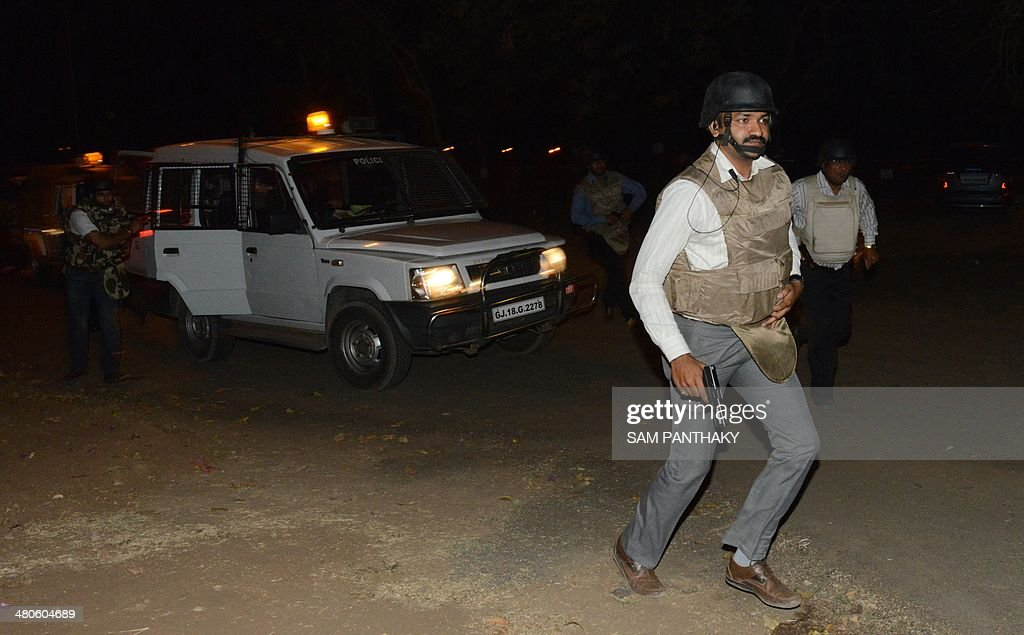 Indian Anti-Terrorist Squad officers arrive to participate part in a security drill at the start of three days of drills at the Akshardham Temple in Gandhinagar, some 30 kms from Ahmedabad, on late March 25, 2014. A 60-member team made up of elite National Security Guards, Chetak Commandos, Anti-Terrorist Squad officers, members of the Special Operations Group (SOG), members of the Gandhinagar-based Fire & Emergency Services and top officials from the Gujarat police participated in the drill. AFP PHOTO / Sam PANTHAKY