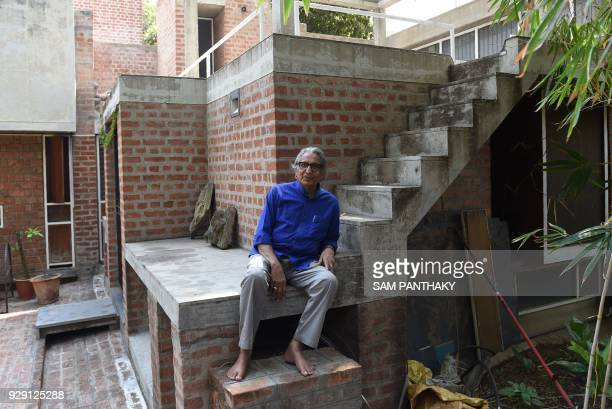 TOPSHOT Indian architect Balkrishna Doshi winner of the Pritzker Architecture Prize poses at his residence in Ahmedabad on March 8 2018 Trailblazing...