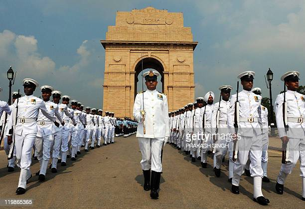Indian armed forces personnel march past India Gate after a tribute ceremony to commemorate twelve years since the victory of the Kargil war in New...