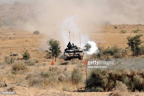 Indian Army battle tank Arjun is operated during the Indian Army Exercise Sudarshan Shakti in Barmer distrcit in Rajasthan on December 5 2011...