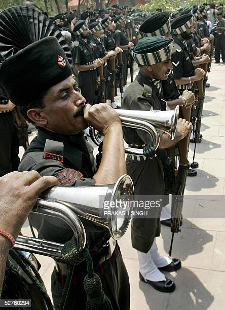 Indian Army buglers play the 'Last Post' as colleagues pay tribute to Indian Lieutenant General Jagjit Singh Aurora by reversing their weapons during...