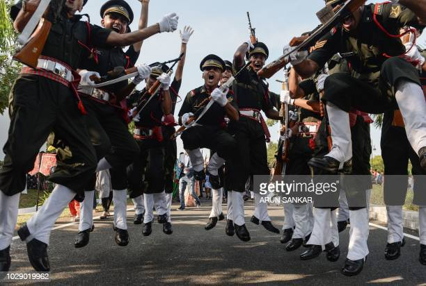 Indian army cadets celebrate after their graduation ceremony at the Officers Training Academy in Chennai on September 8, 2018. - A total of 252...