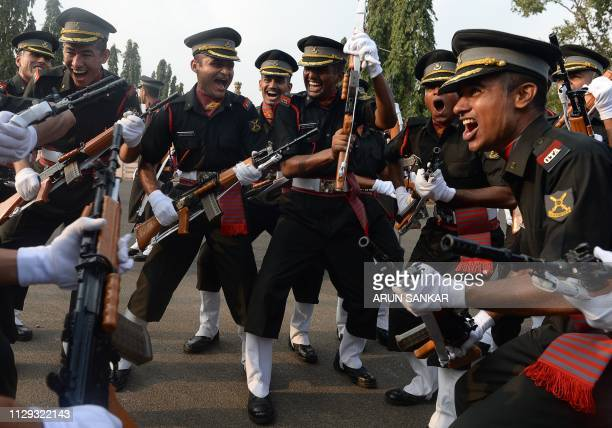 TOPSHOT Indian army cadets celebrate after their graduation ceremony at the Officers Training Academy in Chennai on March 9 2019 A total of 142...