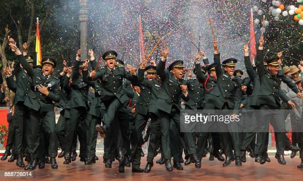 TOPSHOT Indian army cadets celebrate after their graduation ceremony at the Officers Training Academy in Gaya on December 9 2017 / AFP PHOTO /
