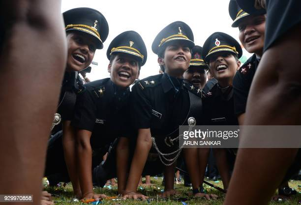 TOPSHOT Indian army cadets celebrate after their graduation ceremony at the Officers Training Academy in Chennai on March 10 2018 A total of 255...