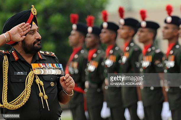 Indian Army Chief General Bikram Singh inspects a guard of honour by the Sri Lankan Army after his arrival in Colombo on December 19 2012 General...