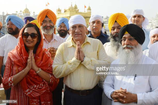 Indian Army Chief General Bipin Rawat and his wife Madhulika Rawat pay respect at the Sikh Shrine Golden Temple in Amritsar on July 8 2018