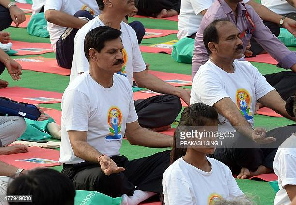 Indian Army Chief General Dalbir Singh Suhag participates in a mass yoga session to mark the International Yoga Day on Rajpath in New Delhi on June...