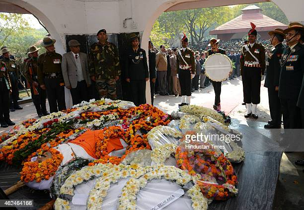 Indian Army Chief General Dalbir Singh Suhag pays his tributes to martyred hero Colonel Munindra Nath Rai during cremation ceremony in the Delhi...