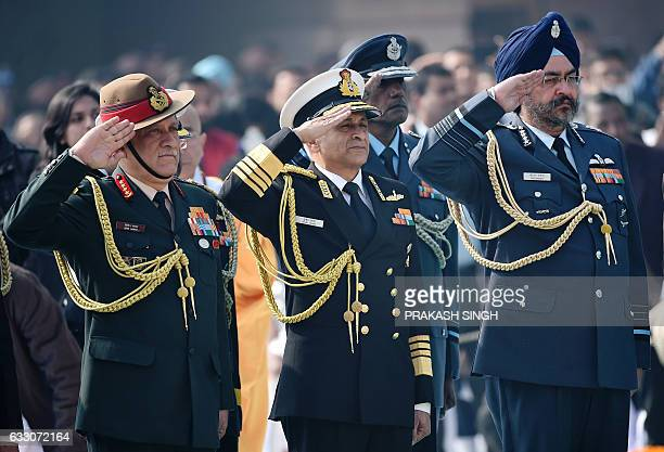 Indian Army Chief Lieutenant General Bipin Rawat Navy Chief Admiral Sunil Lanba and Air Force Chief Air Marshal Birender Singh Dhanoa pay homage at...