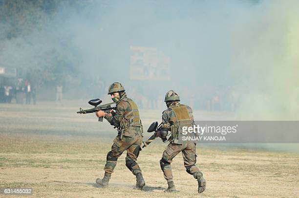 Indian army commandos perform during a mock operation on the second day of the 'Know Your Army' exhibition in Allahabad on January 11 2017 The...
