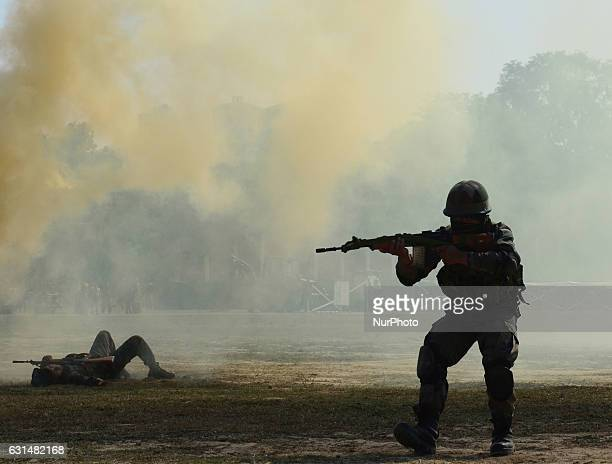 Indian army commandos take part in a surgical strike mock operation on the second day of the 'Know your army exhibition' in Allahabad on January...