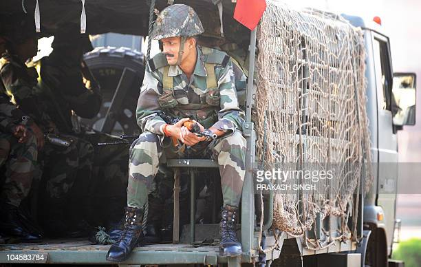 Indian army commandos watch as the Queen's baton relay arrives in New Delhi on October 1 2010 The Queen's Baton arrived in the Indian capital on...