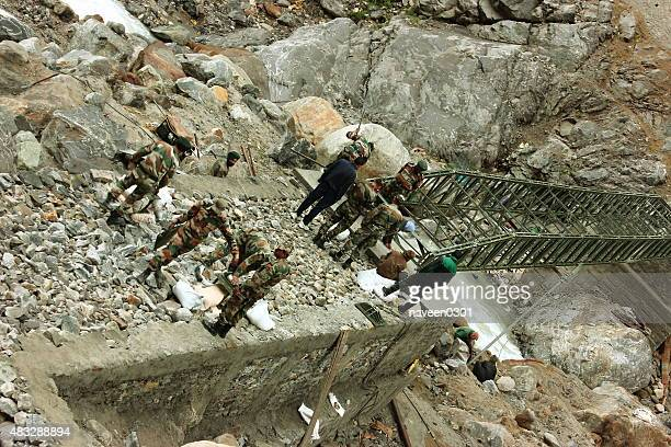 indian army constructing a foot bridge on kedarnath trek route - legal defense stock pictures, royalty-free photos & images