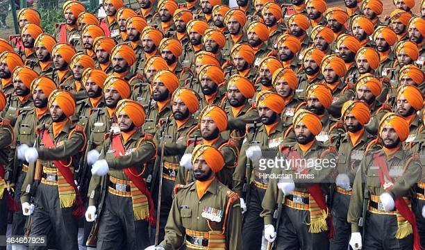 Indian Army contingents passing through the saluting base during the full dress rehearsal for Republic Day Parade at Rajpath on January 23 2014 in...